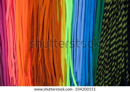 Colorful shoe laces bright background - stock photo