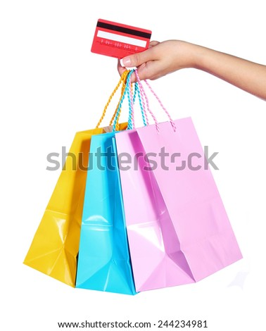 Colorful Shopping Bags and Credit Card in Female Hand isolated on white