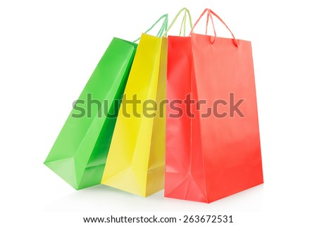 Colorful shopping bags in paper isolated on white, clipping path included - stock photo