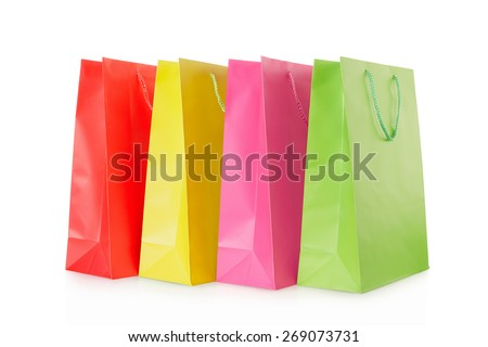 Colorful shopping bags in paper isolated on white, clipping path included