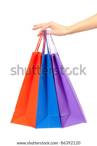 colorful shopping bags set in woman's hand isolated on white - stock photo