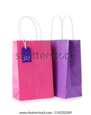 Colorful shopping bags with a tag