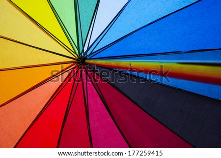 colorful shot of the inside of an umbrella in the symbolic colors of gay rights - stock photo