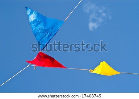colorful signal flags hanging on a wire