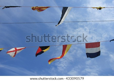 Colorful signal or nautical flags on a cruise ship
