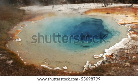 Colorful Silex Spring thermal pool in Yellowstone park - stock photo