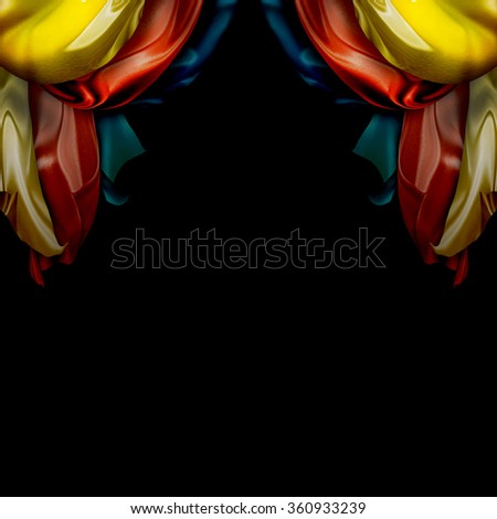 colorful silk curtains on black background - stock photo