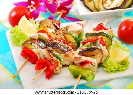 colorful skewers with chicken,aubergine,zucchini,red and green pepper - stock photo