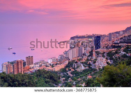 Colorful sky above the Mediterranean sea and Monte Carlo at dusk, Monaco, French Riviera - stock photo