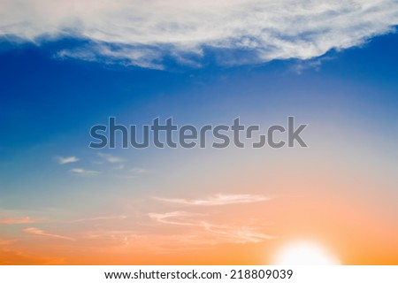 colorful sky and bright sun at sunset