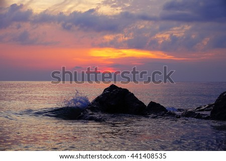 Colorful sky and colorful water in lake reflected in morning time before sunrise,Select focus with shallow depth of field,Soft focus,noise and grain due long exposure:ideal use for background.