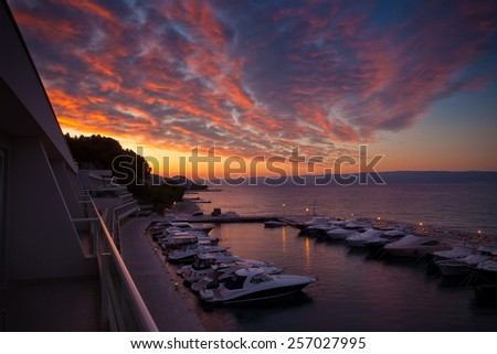 Colorful sky before sunrise on the beach at Split, Croatia - stock photo
