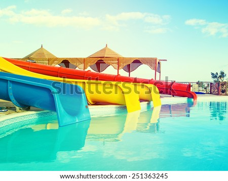 colorful slides at the water park - stock photo