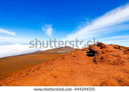 Colorful slope of Haleakala Crater - Haleakala National Park. Nice landscape with bright blue sky with clouds. Maui, Hawaii