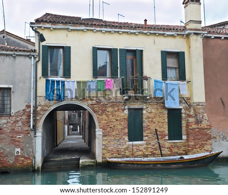 Colorful small building with long passage at Venice canal