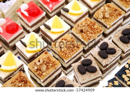 Colorful small fruity and chocolate dezerts - stock photo