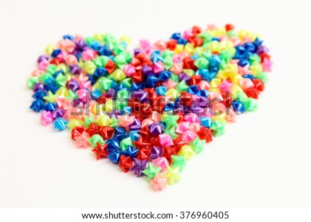 colorful small love stars isolated on white background - stock photo