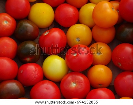Colorful small tomatoes at the market in the country in France