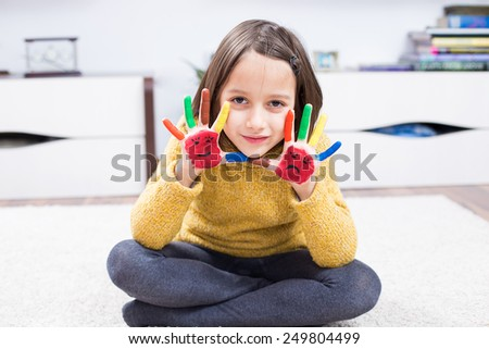Colorful smile girl, with colored hand - stock photo