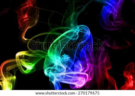 Colorful smoke on black background. studio shot - stock photo