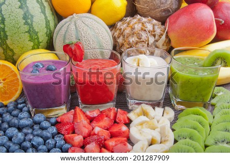 Colorful smoothies and fruits - stock photo