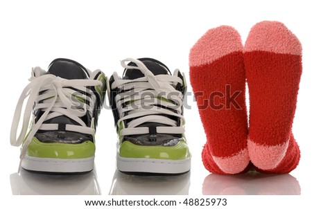 colorful socks and running shoes with reflection on white background - stock photo