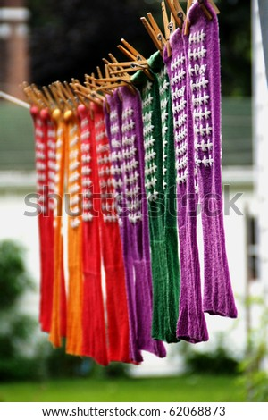 Colorful socks drying on a clothesline - stock photo