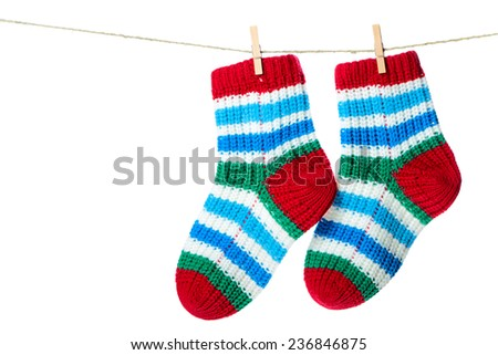 Colorful socks hanging on the clothesline. Image isolated on white background   - stock photo