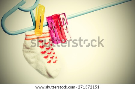 Colorful socks hanging on the clothesline. Image on white background with vignette ,vintage style     - stock photo