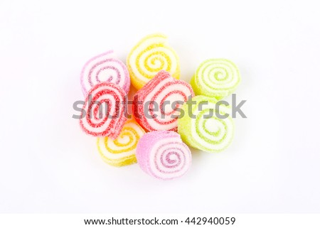 Colorful soft jelly gelatin candy isolated on gray background - stock photo
