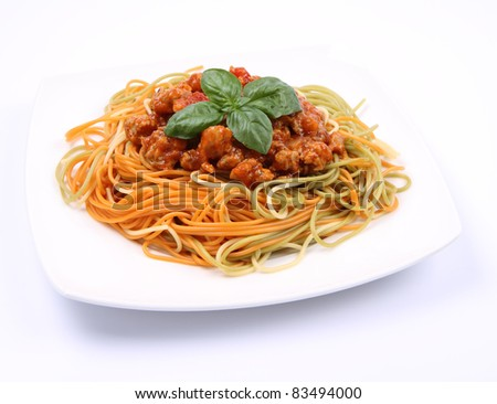 Colorful Spaghetti bolognese on a plate - stock photo