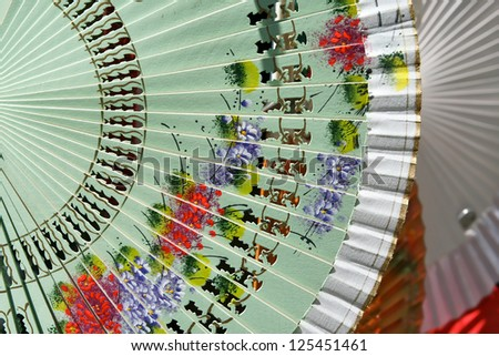 Colorful Spanish Fans arranged for sale in a store in Segovia, Spain - stock photo