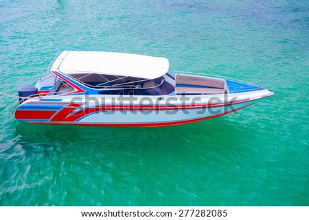 Colorful speed boat in the sea - stock photo
