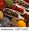 Colorful spices and herbs close up. - stock