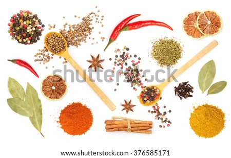 Colorful spices and herbs for cooking background and design isolated - stock photo