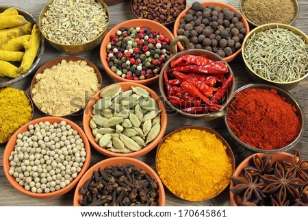 Colorful spices in ceramic and metal containers - beautiful kitchen image.