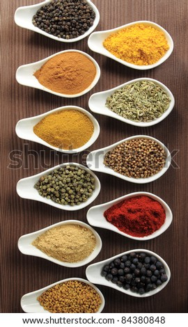 Colorful spices in ceramic containers - beautiful kitchen image. - stock photo