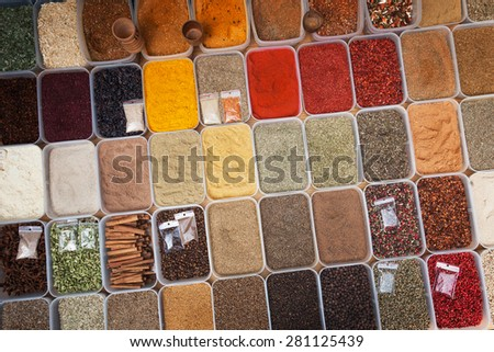 Colorful spices in plastic containers - stock photo