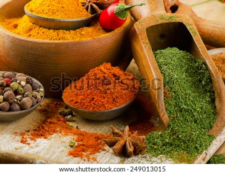 Colorful  spices in spoons. Selective focus - stock photo