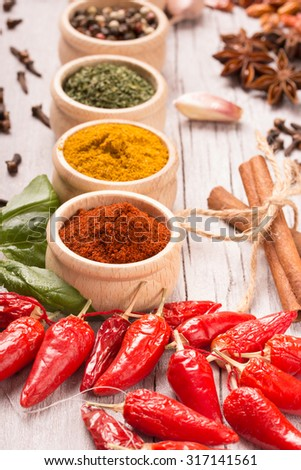 colorful spices on a white wooden table