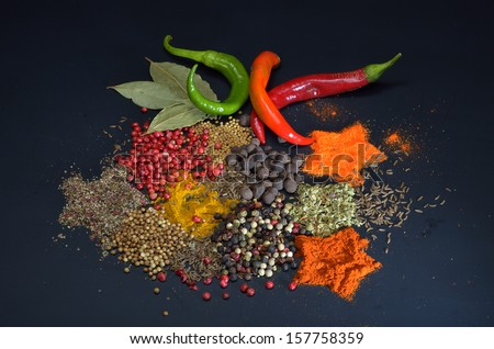 Colorful spices on black background - stock photo