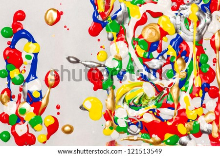 Colorful splatter paint background made with wet acrylic paints on paper - stock photo