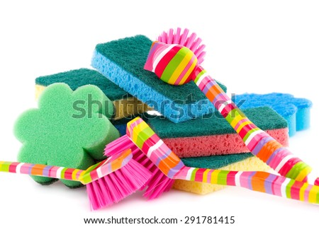 Colorful sponges and brushes isolated on white background. - stock photo