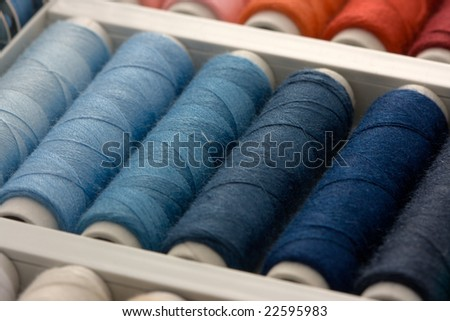 Colorful spools of thread in a box