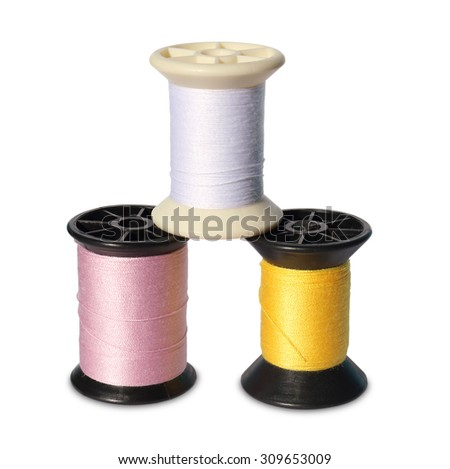 Colorful spools of thread on white background - stock photo
