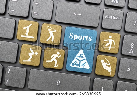 Colorful sports concept key on keyboard - stock photo