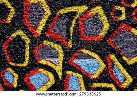 Colorful spray painted shapes on black textured wall abstract background. - stock photo