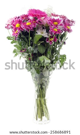 colorful spring flowers bouquet with chrysanthemums in a glass vase - stock photo