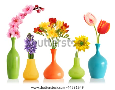 Colorful spring flowers in bright vases isolated on white - stock photo