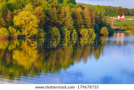 Colorful spring landscape on the lake